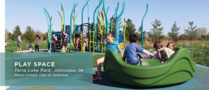 Modern playground with kids playing on jungle gym and equipment
