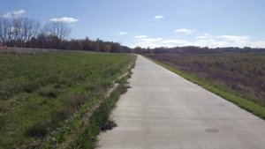 An image of the Mark C. Ackelson Trail near the dam at Easter Lake Park.