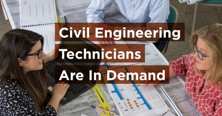 A Civil Engineering Technician sits at a table with engineers to work on a project at Snyder & Associates, a civil engineering firm.