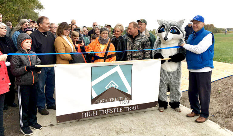 People gathered to celebrate the completion of the first segment of a 9-mile High Trestle Trail extension.