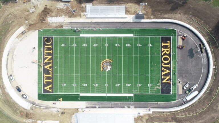 aerial view of Atlantic Trojans football field with surrounding track under construction